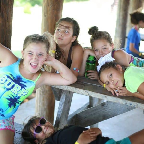 Group of Treehouse Village girls walking up the hill at the best Christian youth camp Shepherd's Fold Ranch.