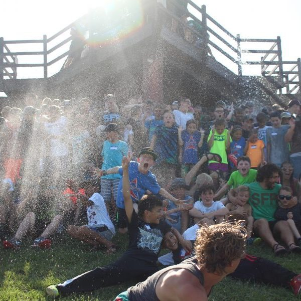 One of the funnest summer camps in Oklahoma, Shepherd's Fold Ranch campers having water dumped on them.
