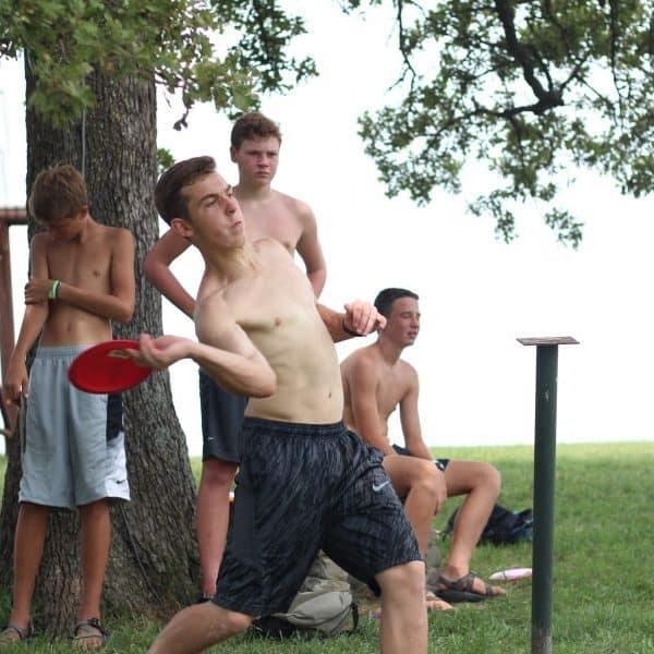 Guys playing disc golf at Christian summer camp Shepherd's Fold Ranch.