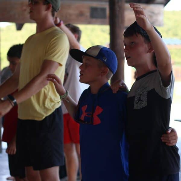 Middle school boys at Christian summer camp praising God. This is Shepherd's Fold Ranch