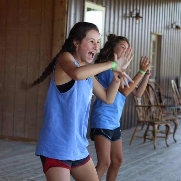 Middle school girls as Christian summer camp dancing