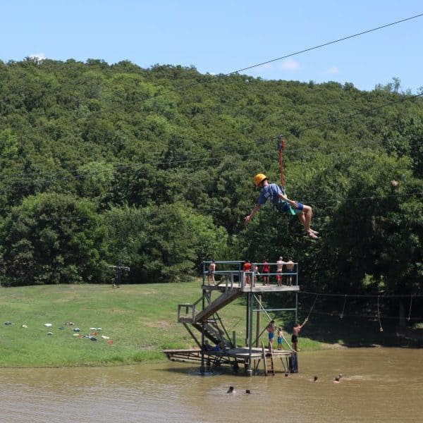 Awesome zip line over pond as Shepherd's Fold Ranch an Oklahoma summer camp