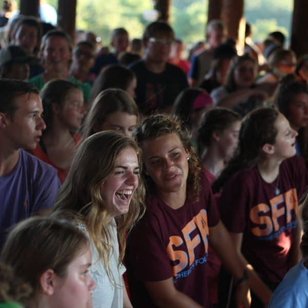 Christian camp Shepherd's Fold Ranch has campers at a night meeting