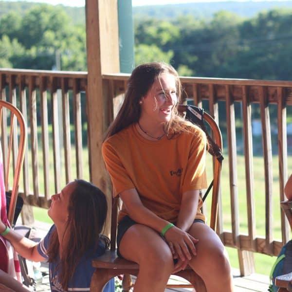 Summer camp teen girls talking at Shepherd's Fold Ranch
