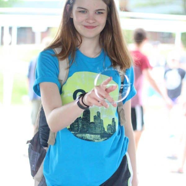 Girl playing with bubbles at Youth Camp Shepherd's Fold Ranch