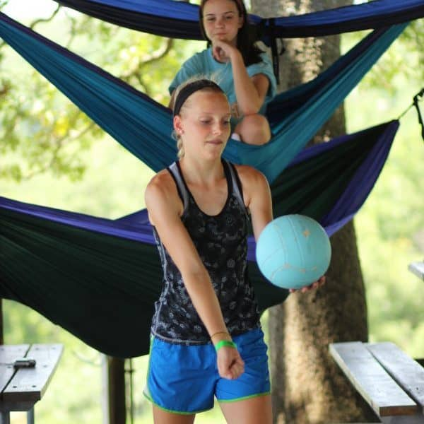 Ranch Campers at Christian Youth Camp Shepherd's Fold Ranch playing volleyball and hammocks